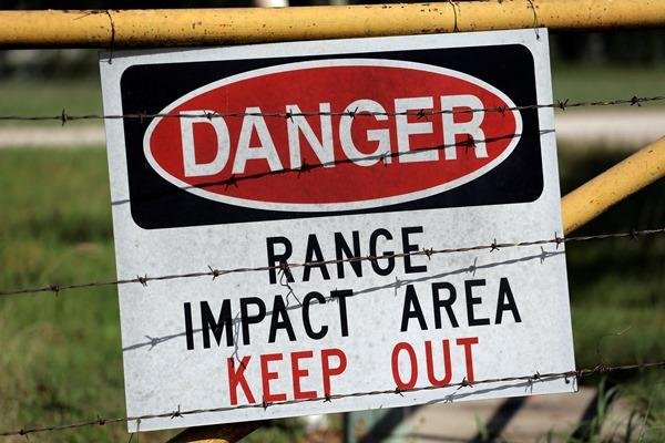 A warning sign is posted at a gate entrance at Texas Army National Guard Camp Swift, Wednesday, July 15, 2015, in Bastrop, Texas. (AP Photo/Eric Gay)