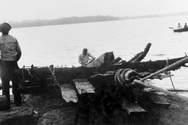 In this 1934 photo released by the Naval History and Heritage Command, remains of the hull of Royal Savage are raised from Lake Champlain.  (U.S. Navy Photo Courtesy of Hudson Hagglund, Naval History and Heritage Command via AP)