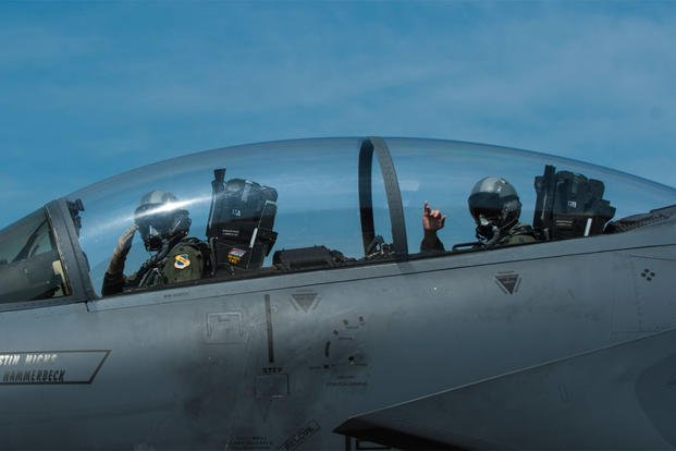 Lt. Col. Paul Hibbard, a 333rd Fighter Squadron instructor pilot, and Capt. Justin Thompson, a 333rd FS pilot, signal their crew chief as they taxi, July 22, 2015, at Seymour Johnson Air Force Base, N.C. (U.S. Air Force photo/Airman Shawna L. Keyes)