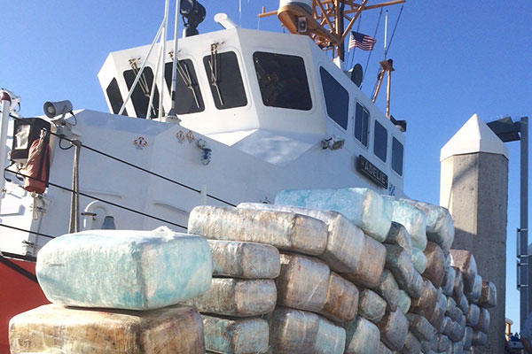 Bales of interdicted marijuana are stacked on the pier in San Diego in front of the Coast Guard Cutter Adelie Aug. 29, 2015. (U.S. Coast Guard Photo)