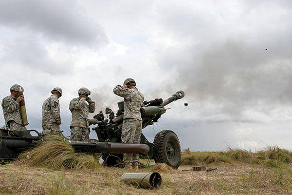 Paratroopers fire rounds from an M119A3 howitzer on Fort Bragg, N.C., during Combined Joint Operational Access Exercise 15-01. The M119 series of howitzers is a proven workhorse now made better. (U.S. Army/ Staff Sgt. Jason Hull)