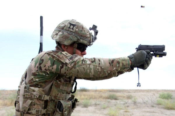 A 101st Airborne Division soldier fires a Sig Sauer pistol during weapons training May 29, 2015 at Tactical Base Gamberi in eastern Afghanistan. (U.S. Army photo by Capt. Charlie Emmons)