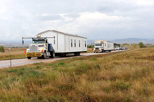The first two manufactured housing units that are part of FEMA's response and recovery efforts related to severe storms and flooding on the Pine Ridge Indian Reservation arrived at Ellsworth Air Force Base Oct. 8, 2015. (U.S. Air Force/A1C Denise Nevins)