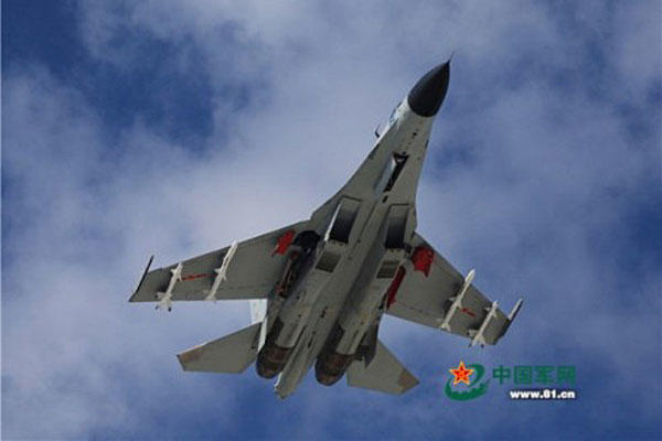 A J-11 fighter flies above the South China Sea on Oct. 30, 2015. An aviation division under the South China Sea Fleet of the Chinese PLA Navy carried out on Friday training on real air battle tactics. Chinamil/Fan Huaijiang