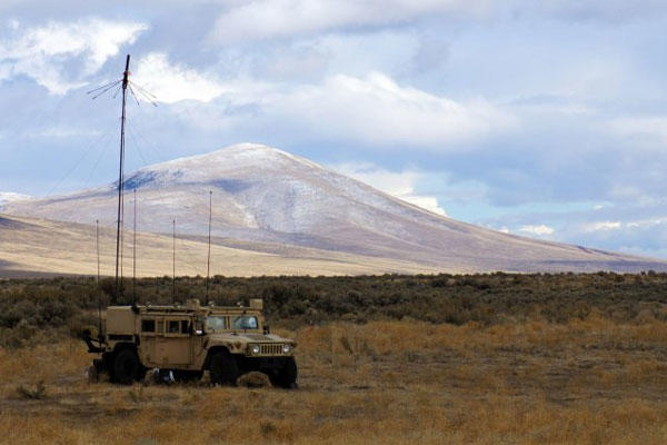 Soldiers operate a retransmission point from a Humvee at the Yakima Training Center, Wash., during the 16th Combat Aviation Brigade's aerial gunnery, Oct. 24, 2012. (U.S. Army photo)