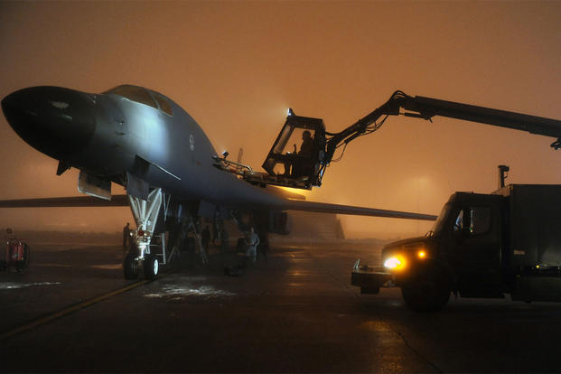Airmen from the 34th Bomb Squadron work to de-ice a B-1B Lancer on March 26, 2011, at Ellsworth Air Force Base, S.D, in preparation for a mission supporting Operation Odyssey Dawn. (Photo: Senior Airman Adam Grant)