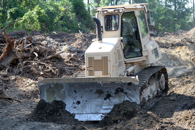 A U.S. Soldier in the 1782nd Engineer Company, South Carolina Army National Guard, operates a bulldozer while conducting annual training at the Savannah River Site in Aiken, South Carolina, June 13, 2016. (U.S. Army/Sgt. Brad Mincey)
