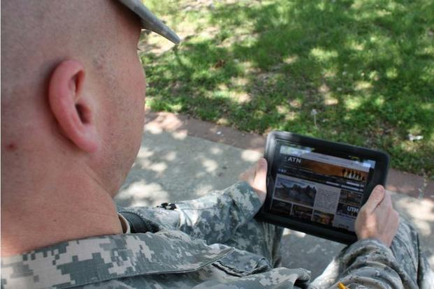 Maj. David Vodarick peruses the Army Training Network on his computer tablet. (Army/Mike Casey)
