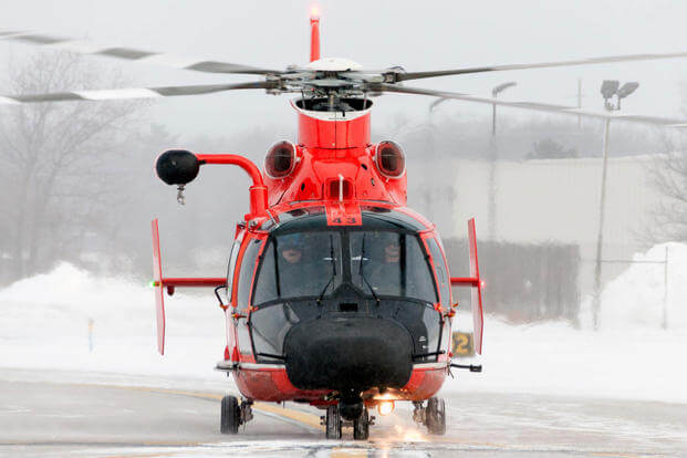 An aircrew from Coast Guard Air Station Traverse City, Michigan, taxis down the runway and prepares for departure at Cherry Capital Airport aboard an MH-65 Dolphin helicopter Feb. 4, 2017. (U.S. Coast Guard photo/Air Station Traverse City)
