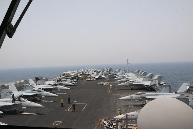 Military.com spent time aboard the USS George H. W. Bush aircraft carrier to observe its operations while underway May 3-4, 2017, in the Persian Gulf. (Photos by Hope Hodge Seck/Military.com)