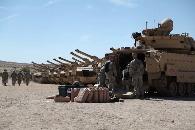 Soldiers ensure their vehicles are in good order before the activity heats up with the 1st Armored Brigade Combat Team, 34th Red Bull Infantry Division in  their training  rotation at Fort Irwin, California. (Minnesota National Guard/ Capt. Zach Strom)