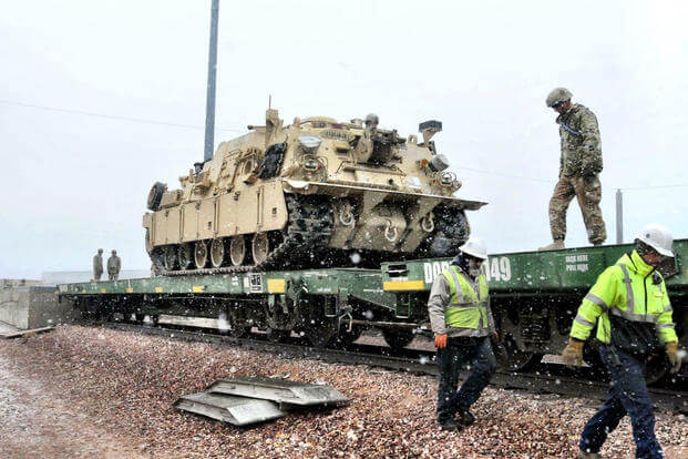 A Soldier from 64th Brigade Support Battalion, 3rd Armored Brigade Combat Team, 4th Infantry Division, prepares to tie down an M88A2 recovery vehicle to a train car at Fort Carson, Colorado, Dec. 2, 2016. (U.S. Army photo/Staff Sgt. Ange Desinor)