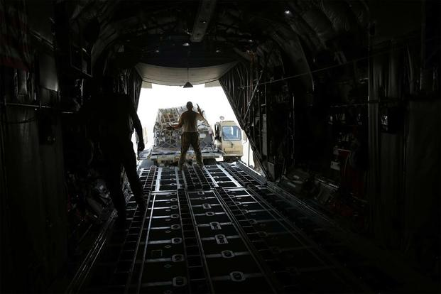 SOUTHWEST ASIA - Loadmasters and cargo aerial porters ready the C-130 before takeoff from home station. (Photo: Military.com/Oriana Pawlyk)