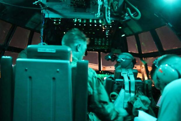 A C-130 crew gets itself ready during the night airlift ops leg of a mission. (Photo: Oriana Pawlyk/Military.com)