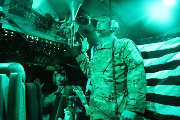 Sgt Justin, with the 156th Airlift Squadron, reenlists in a C-130 over Iraq. (Photo: Oriana Pawlyk/Military.com)