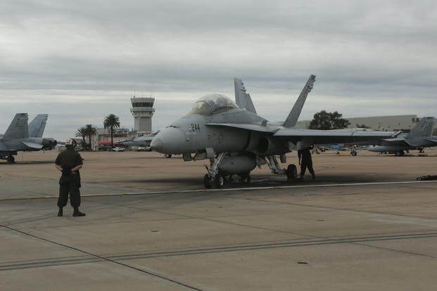 A Marine with Marine Fighter Attack Training Squadron (VMFAT) 101, 3rd Marine Aircraft Wing prepares an F/A-18 Hornet for taxi at Marine Corps Air Station Miramar, Calif., March 21, 2017. (U.S. Marine Corps photo/Lance Cpl. Liah Kitchen)