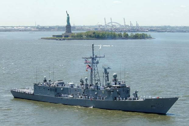 The Oliver Hazard Perry-class guided missile frigate USS Boone (FFG-28) sails past the Statue of Liberty in the Hudson River during the kickoff of Fleet Week 2002. (U.S. Navy/Michael W. Pendergrass)