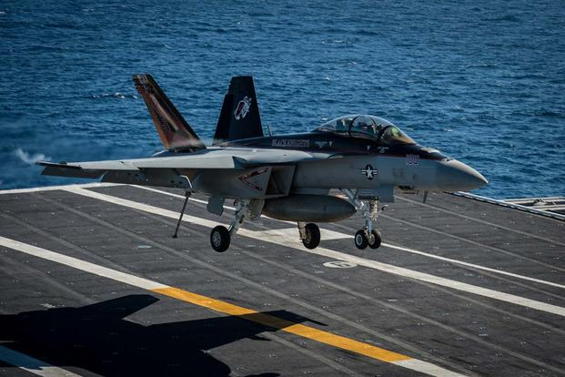 An F/A-18F Super Hornet assigned to the Black Knights of Strike Fighter Squadron (VFA) 154 lands on the flight deck of the aircraft carrier USS Nimitz (CVN 68). (U.S. Navy/Mass Communication Specialist 3rd Class Raul Moreno Jr.)