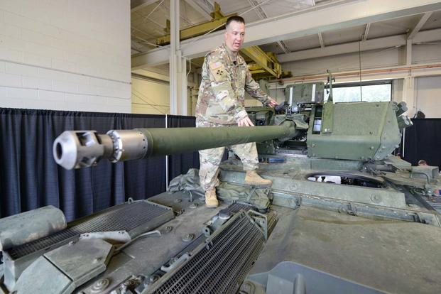 Sgt. 1st Class Nicholas Young, senior NCO of the Army's Stryker combat vehicle program, discusses the 30mm cannon on the Infantry Carrier Vehicle-Dragoon vehicle at Aberdeen Proving Ground, Md., Aug. 16, 2017. (Photo Credit: Sean Kimmons)