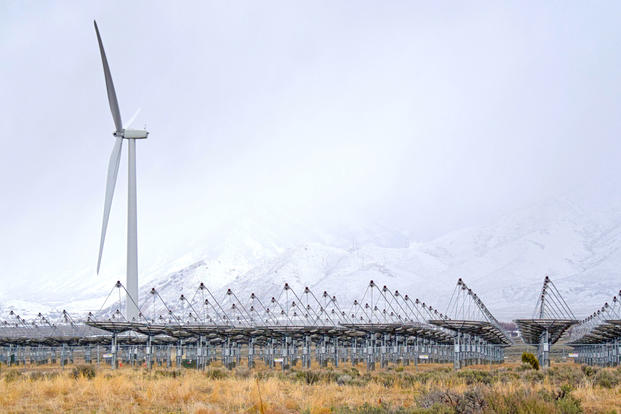 A second wind turbine towers nearly 300 feet above the nearby Stirling solar array at Tooele Army Depot, Utah, March 22, 2016. (U.S. Army photo by John Prettyman)