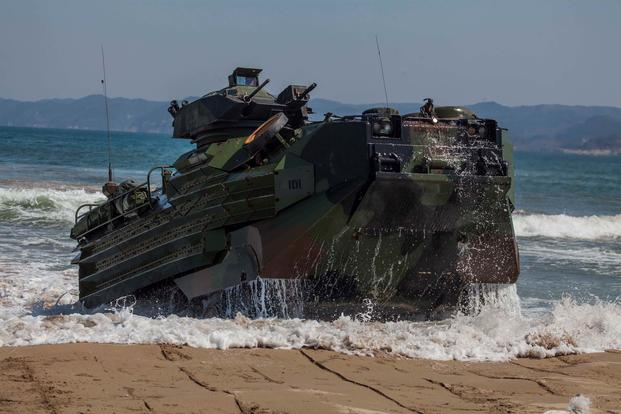 A U.S. Marine Corps AAV-P7/A1 Amphibious Assault Vehicle reaches the shoreline during a combined amphibious assault exercise. (U.S. Marine Corps/Gunnery Sgt. Ismael Pena)