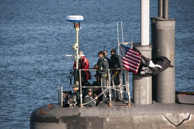 Cmdr. Melvin Smith, commanding officer of the Seawolf-class submarine USS Jimmy Carter (SSN 23), looks on as the submarine transits the Hood Canal on its way home to Naval Base Kitsap-Bangor. (U.S. Navy/Lt. Cmdr. Michael Smith)