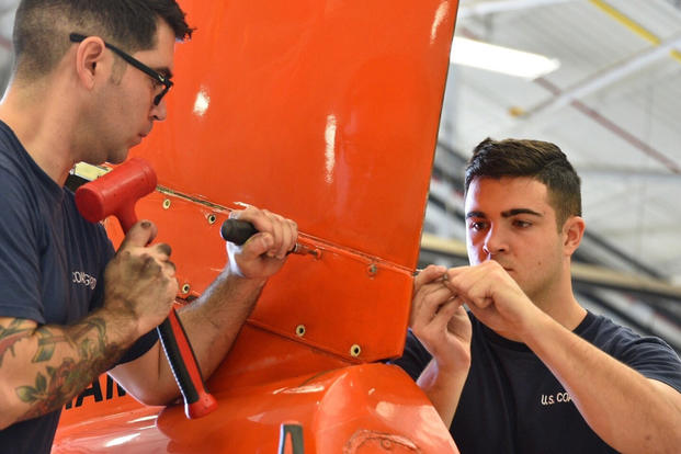 Coast Guard personnel pre-stage aircraft and make final checks at Aviation Training Center Mobile, Ala., Sept. 10, 2017, in preparation for Hurricane Irma response operations. (U.S. Coast Guard photo/Petty Officer 1st Class Patrick Kelley)