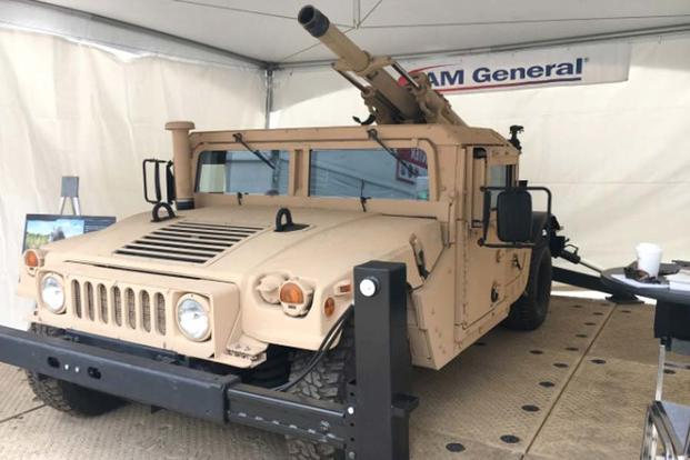 Mandus Group has developed a stabilized 105mm cannon system designed to be mounted on the back of Humvees, Joint Light Tactical Vehicles and similar-sized platforms. (Matt Cox/Military.com)