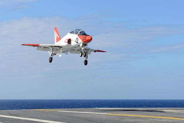 A T-45C Goshawk, assigned to Training Air Wing (TRAWING) 1, prepares to land on the flight deck aboard USS Harry S. Truman, Sept. 16, 2017. (U.S. Navy photo/Mass Communication Specialist 2nd Class Anthony Flynn)