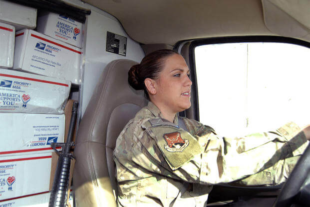 Senior Airman Shannon Koutsovalas, 451st Air Expeditionary Wing mail clerk, transports a truck-load of packages and mail back to Camp Losano for storage here July 31, 2012. (Photo: Master Sgt. Russell Martin)