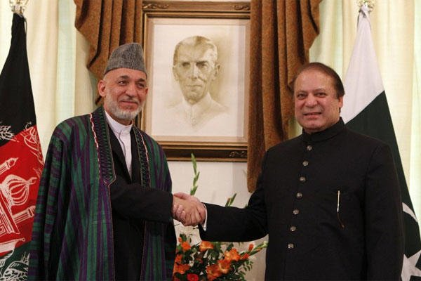 Afghan President Hamid Karzai, left, shakes hand with Pakistani Prime Minister Nawaz Sharif prior to their meeting in Islamabad, Pakistan, Monday, Aug. 26, 2013.