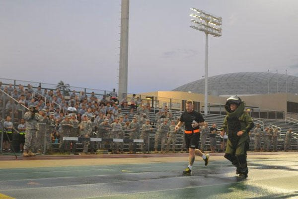 1st Lt. Ashley Sorensen of the 303rd Explosive Ordnance Disposal Battalion attempts a world record by running a mile in 11 minutes, 6 seconds, while wearing a bomb disposal suit, Sept. 23, 2013. (U.S. Army photo/Sgt. 1st Class Mary E. Ferguson)