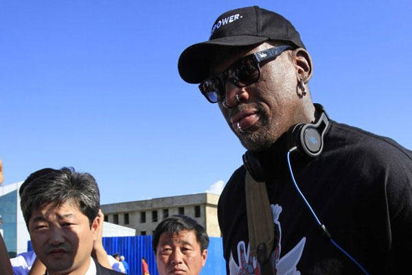 Former NBA star Dennis Rodman arrives at Pyongyang airport, North Korea, Tuesday, Sept. 3, 2013.