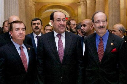 raq's Prime Minister Nouri al-Maliki, center, walks with members of the House Foreign Affairs Committee.