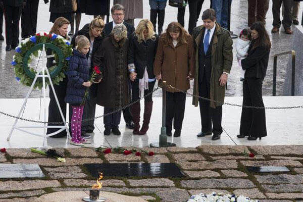 Members of the Kennedy family, including former US Ambassador to Ireland Jean Kennedy Smith, fourth from left, hold hands as they pay their respects at the gravesite of President John F. Kennedy, Friday, Nov. 22, 2013.