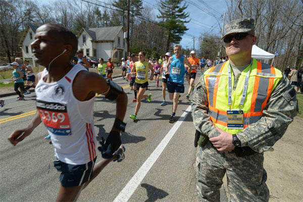 Army Spc. Brandon Smith, 169th Military Police Company, Rhode Island Army National Guard, at the starting line of the 2014 Boston Marathon, April 21, 2014. U.S. Army photo by Staff Sgt. Jerry Saslav