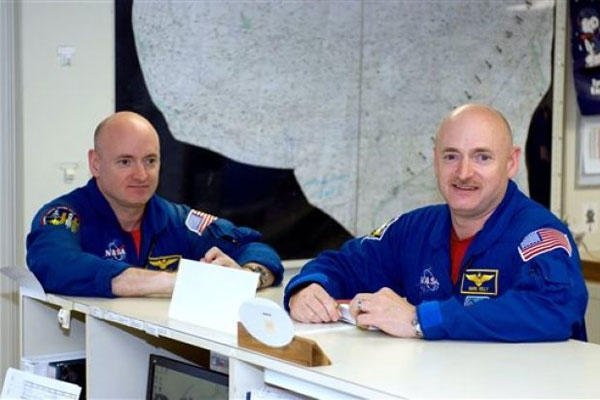 This undated file photo provided by NASA shows astronauts Mark Kelly, right, and Scott Kelly in the check-out facility at Ellington Field near NASA's Johnson Space Center in Houston. (AP photo)