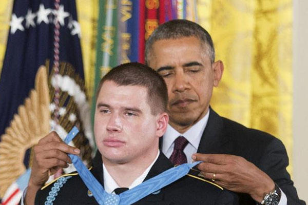 President Barack Obama awards the Medal of Honor to former Army Sgt. Kyle J. White during a ceremony in the East Room of the White House in Washington, Tuesday, May 13, 2014. (AP Photo)