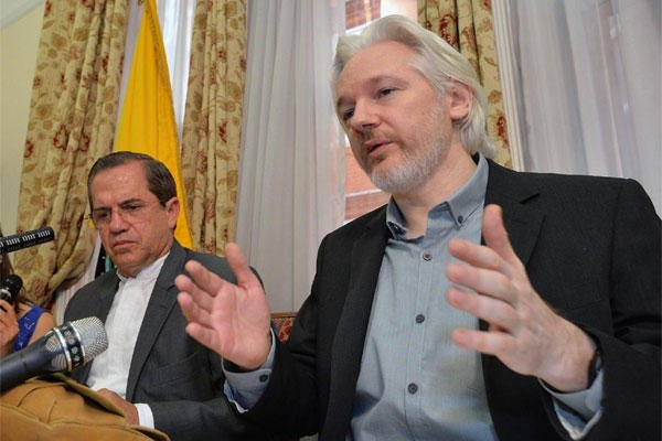 "Ecuador's Foreign Minister Ricardo Patino and WikiLeaks founder Julian Assange speak at a press conference inside the Ecuadorian Embassy in London, where he confirmed he ""will be leaving the embassy soon"", Monday Aug. 18, 2014. (AP Photo / John Stillwell)"
