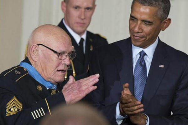 President Barack Obama, right, applauds as retired Army Command Sgt. Maj, Bennie G. Adkins salutes after receiving the Medal of Honor in the East Room of the White House, on Monday, Sept. 15, 2014 (AP Photo/Evan Vucci)