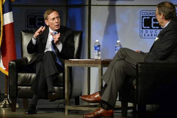 David Petraeus speaks with moderator Andy Alexander at the Ellie Caulkins Opera House in Denver, on Sept. 11. (Aaron Ontiveroz / AP)