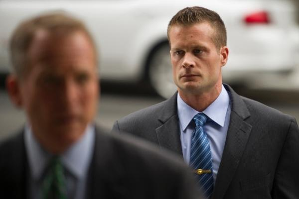 In this June 11, 2014 file photo, former Blackwater Worldwide guard Evan Liberty, right, arrives at federal court in Washington. (AP photo)