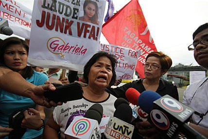 In this Oct. 18, 2014, photo, Julita Laude, mother of killed transgender Jennifer Laude, talks to reporters during a rally near the USS Peleliu, where U.S. Marine Pfc. Joseph Scott Pemberton is said to be held, at the Subic Bay free port. Aaron Favila/AP