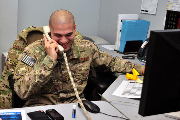 Airman 1st Class Frank Perez-Castillo smiles during a surprise phone call from Chief Master Sgt. of the Air Force James A. Cody Dec. 24, 2014, at Bagram Airfield, Afghanistan. (U.S. Air Force photo/Staff Sgt. Whitney Amstutz)