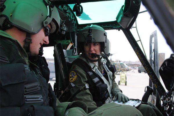 Air Force Maj. Mary Clark, right, instructs Air Force 1st Lt. David Shadoin during preflight procedures Dec. 16, 2014, at Kirtland Air Force Base, N.M. (U.S. Air Force photo by Jim Fisher)