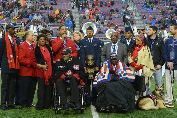 "Tuskegee Airmen Homer Hogues and Calvin Spann receive the Omar N. Bradley ""Spirit of Independence Award"" on behalf of all of the Tuskegee Airmen Dec. 27, 2014. (U.S. Air Force photo/Senior Airman Joseph A. Pagán Jr.)"