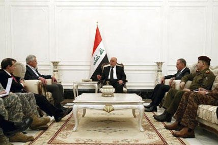 U.S. Secretary of Defense Chuck Hagel, third left, meets with Iraqi Prime Minister Haider al-Abadi, center, and aides in Baghdad, Iraq, Tuesday, Dec. 9, 2014. (AP Photo/Mark Wilson, Pool)
