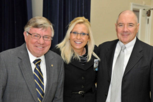 Sharon Helman, who was recently fired as director of the VA hospital in Phoenix, stands with her onetime boss, Max Lewis (right), and another former VA official, Nathan Geraths (left) in this 2011 agency photo.