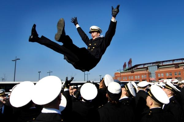Midshipmen traditionally toss each other in the air after Navy touchdowns. (DoD photo)