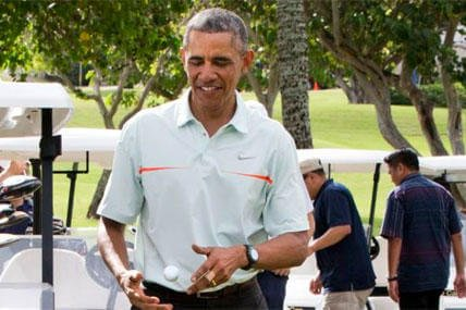President Obama tosses a golf ball between his hands after finishing a game of golf Wednesday, Dec. 24, 2014, at Marine Corps Base Hawaii's Kaneohe Klipper Golf Course in Kaneohe. (AP Photo/Jacquelyn Martin)